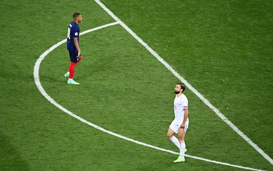 Kylian Mbappe of France makes his way towards the box to take his side's fifth penalty - Getty