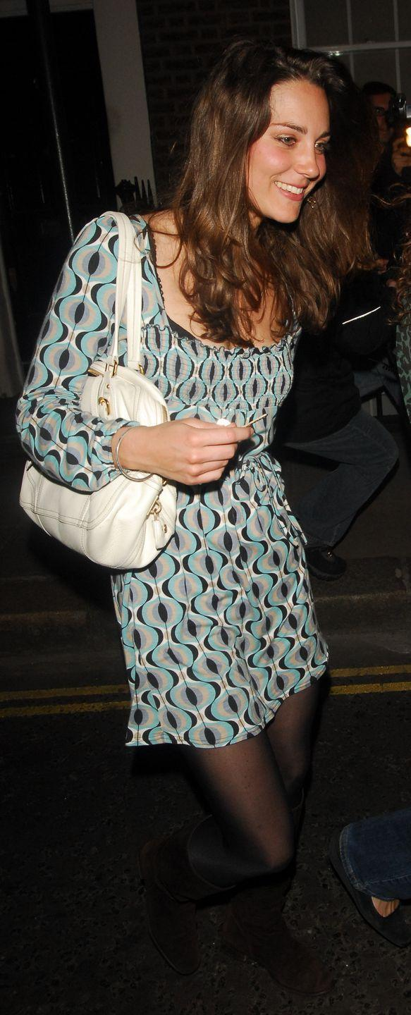 <p>Spotted in London wearing a printed dress and black tights. <br></p>