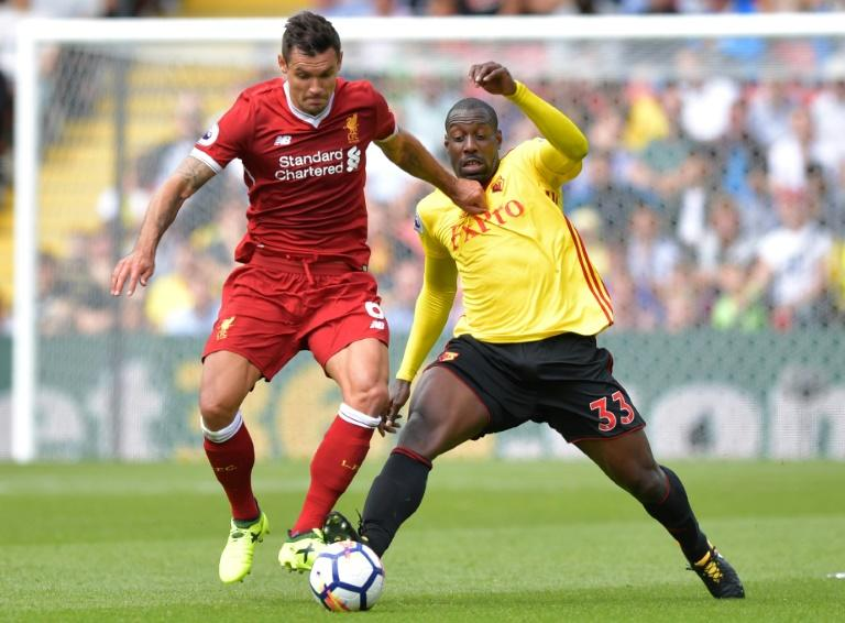 Liverpool's defender Dejan Lovren (L) vies with Watford's striker Stefano Okaka during the English Premier League football match August 12, 2017