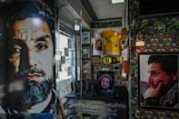 In many parts of Afghanistan, Ahmad Shah Massoud's face can be seen on murals, billboards, and even T-shirts (AFP/Aamir QURESHI)