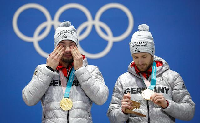 Medals Ceremony - Luge - Pyeongchang 2018 Winter Olympics - Men's Doubles - Medals Plaza - Pyeongchang, South Korea - February 16, 2018 - Gold medalists Tobias Wendl and Tobias Arlt of Germany on the podium. REUTERS/Kim Hong-Ji TPX IMAGES OF THE DAY
