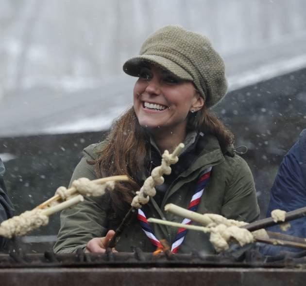 Catherine, Duchess of Cambridge cooks dough around a campfire at the Great Tower Scout camp on March 22, 2013 in Windermere, Cumbria, United Kingdom -- Getty Images