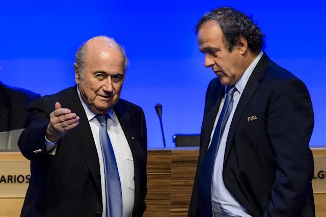 Sepp Blatter and Michel Platini met their downfall with a mysterious 2 mn Swiss francs transfer in 2011 from the FIFA president to his deputy (AFP Photo/Fabrice Coffrini)