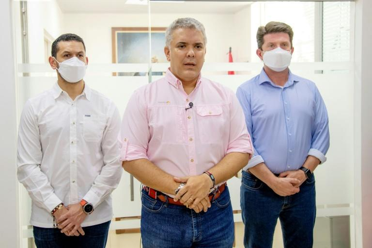 This handout picture from the Colombian government shows President Ivan Duque (C) speaking next to Interior Minister Daniel Palacios (L) and Defense Minister Diego Molano, in Cucuta, Colombia on June 25, 2021 after an attack on their helicopter