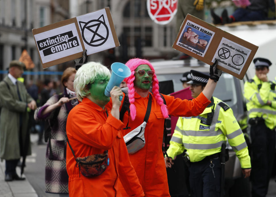 Climate protestors block a road in central London Monday, Oct. 7, 2019. Extinction Rebellion movement blocked major roads in London, Berlin and Amsterdam on Monday at the beginning of what was billed as a wide-ranging series of protests demanding new climate policies. (AP Photo/Alastair Grant)