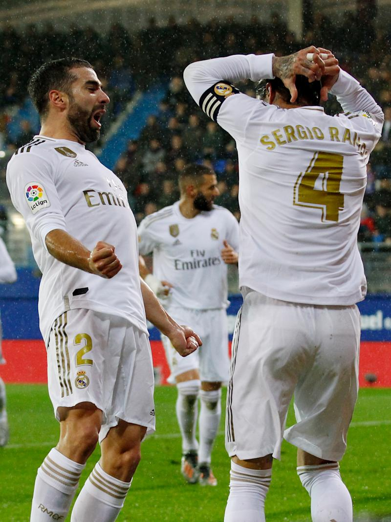 EIBAR, SPAIN - NOVEMBER 9: Sergio Ramos of Real Madrid celebrates 0-2 with Dani Carvajal of Real Madrid during the La Liga Santander match between Eibar v Real Madrid at the Estadio Municipal de Ipurua on November 9, 2019 in Eibar Spain (Photo by David S. Bustamante/Soccrates/Getty Images)