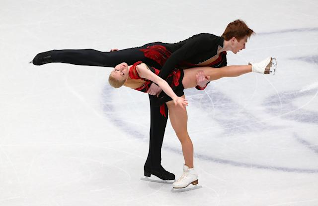 Figure Skating - World Figure Skating Championships - The Mediolanum Forum, Milan, Italy - March 21, 2018 Russia's Evgenia Tarasova and Vladimir Morozov during the Pairs Short Programme REUTERS/Alessandro Bianchi