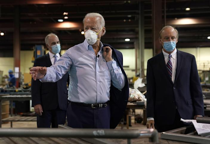 "Democratic presidential candidate Joe Biden, with CEO and President, Bob McGregor (R), takes a tour at McGregor Industries in Dunmore, Pennsylvania, July 9, 2020. - Biden has unveiled a sweeping $700 billion plan Thursday to help the battered US economy recover from the coronavirus crisis, a direct challenge to Donald Trump's ""America First"" agenda as they square off in the presidential race. (Photo by TIMOTHY A. CLARY / AFP) (Photo by TIMOTHY A. CLARY/AFP via Getty Images)"