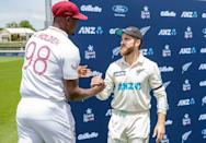 West Indies captain Jason Holder (L) congratulates his New Zealand's counterpart Kane Williamson for victory in the first Test cricket match at Seddon Park in Hamilton on December 6, 2020.