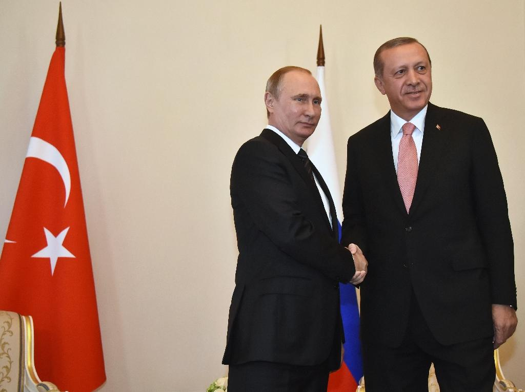 Russian President Vladimir Putin (left) shakes hands with Turkish President Recep Tayyip Erdogan in Konstantinovsky Palace outside Saint Petersburg on August 9, 2016