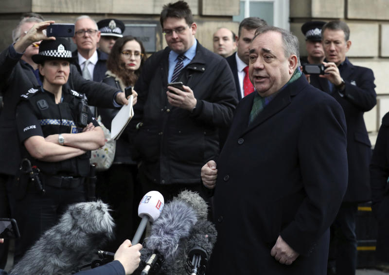 Former Scottish leader Alex Salmond, center, speaks to the media after leaving the High Court in Edinburgh, Thursday Nov. 21, 2019. Salmond, one of the country's best-known politicians, appeared in court faces a total of 14 charges of attempted rape, sexual assault and indecent assault against 10 women. (Andrew Milligan/PA via AP)