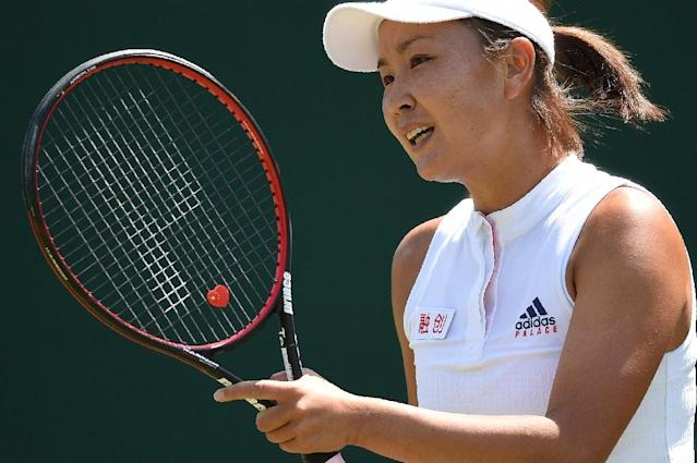 Chinese tennis veteran Peng Shuai denies wrongdoing after being banned for six months and fined $10,000 (AFP Photo/Oli SCARFF )