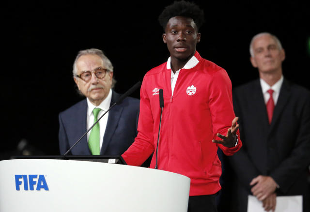 FILE - In this Wednesday, June 13, 2018 file photo, Alphonso Davies of Canada speaks at the FIFA congress on the eve of the opener of the 2018 soccer World Cup in Moscow. (AP Photo/Alexander Zemlianichenko, file)