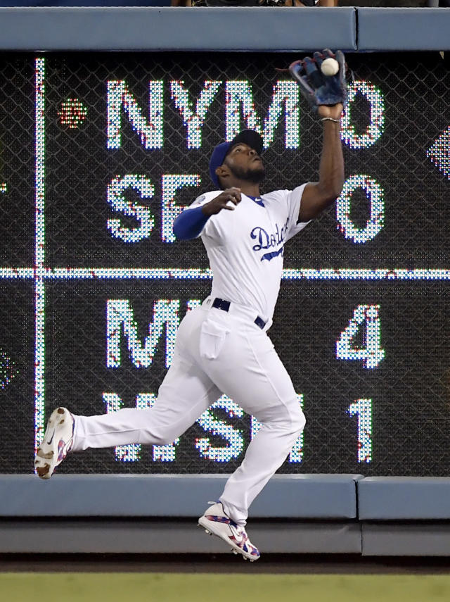 Los Angeles Dodgers right fielder Yasiel Puig catches a ball hit by Arizona Diamondbacks' A.J. Pollock during the third inning of a baseball game Friday, Aug. 31, 2018, in Los Angeles. (AP Photo/Mark J. Terrill)