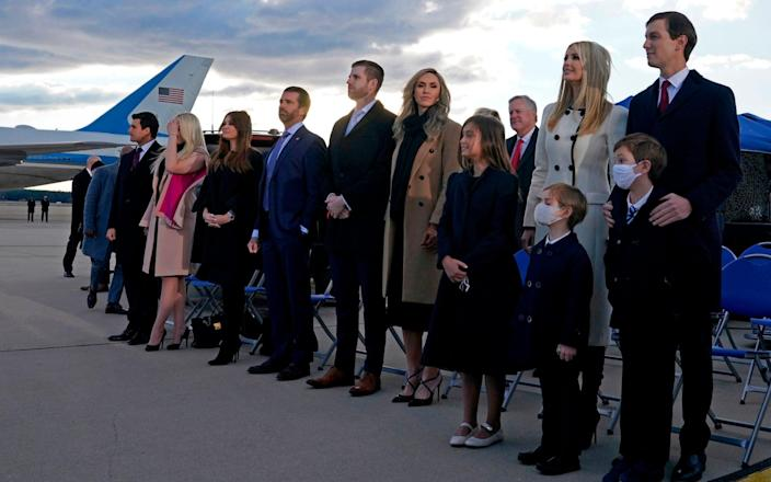 Ivanka Trump (2nd R), husband Jared Kushner (R), their children, Eric (C-R) and Donald Jr. (C-R) and Trump family members stand on the tarmac at Joint Base Andrews - ALEX EDELMAN/AFP