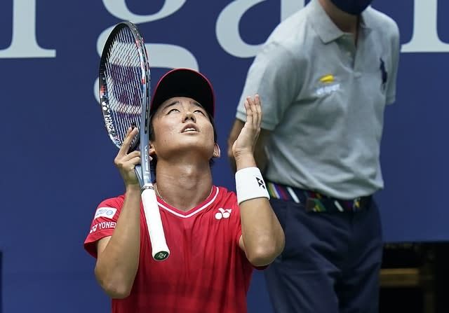 Yoshihito Nishioka, of Japan, reacts after losing a point