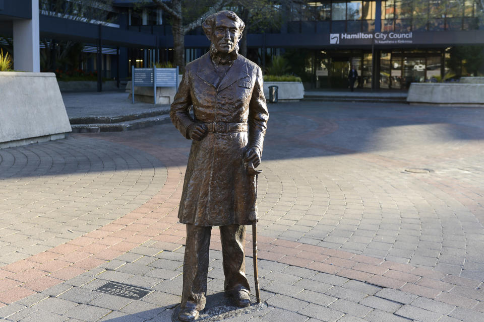 This image provided by Hamilton City Council, shows the bronze statue of British Captain John Fane Charles Hamilton before it was removed from a square in central Hamilton, New Zealand, Friday, June 12, 2020. The New Zealand city of Hamilton on Friday removed the bronze statue of the British naval officer the city is named after a man who is accused of killing indigenous Maori people in the 1860s. (Hamilton City Council via AP)