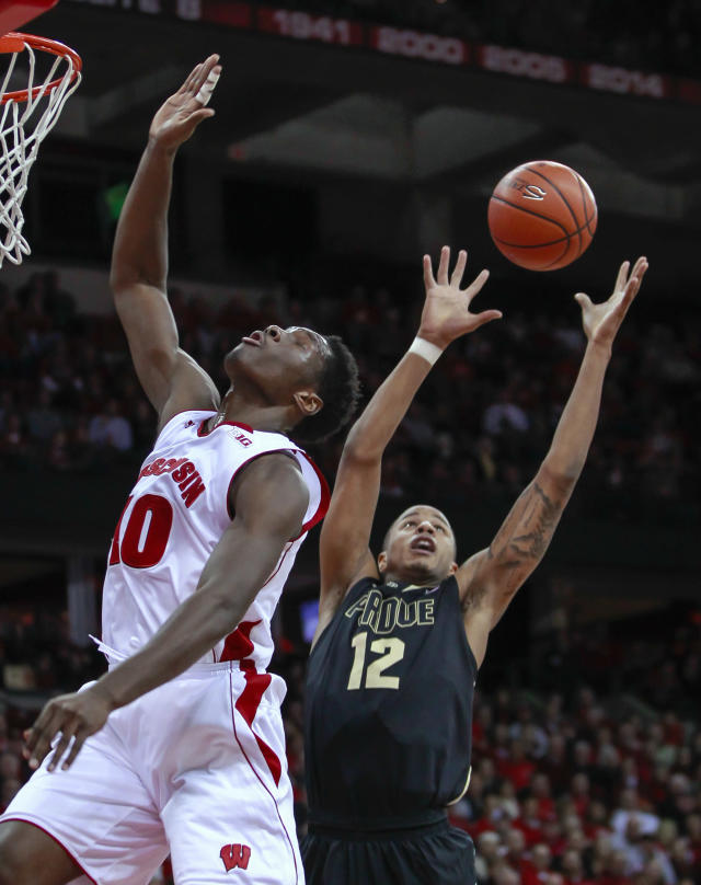 Purdue's Vince Edwards (12) gets a offensive rebound away from Wisconsin's Nigel Hayes during the first half of an NCAA college basketball game Wednesday, Jan. 7, 2015, in Madison, Wis. (AP Photo/Andy Manis)