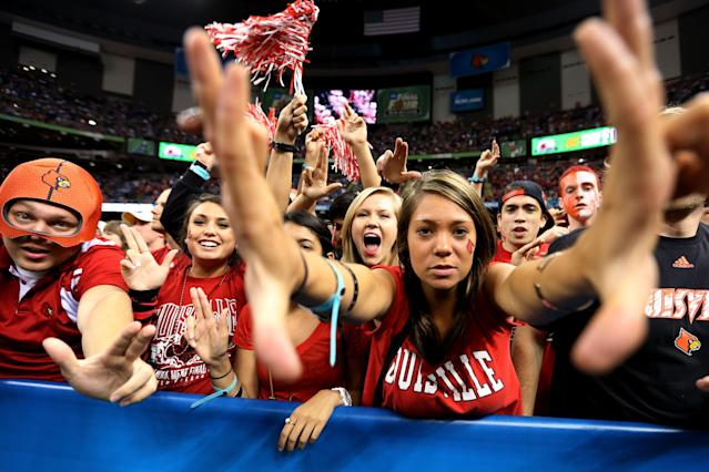 NEW ORLEANS, LA - MARCH 31: Louisville Cardinals fans cheer on their team before taking on the Kentucky Wildcats during the National Semifinal game of the 2012 NCAA Division I Men's Basketball Championship at the Mercedes-Benz Superdome on March 31, 2012 in New Orleans, Louisiana. (Photo by Chris Graythen/Getty Images)