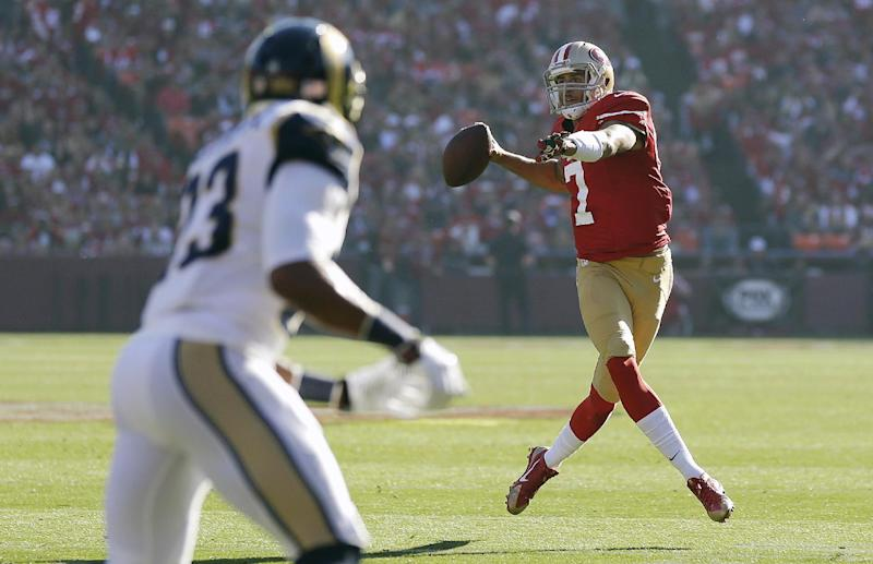 San Francisco 49ers quarterback Colin Kaepernick (7) passes against the St. Louis Rams during the first quarter of an NFL football game in San Francisco, Sunday, Dec. 1, 2013. (AP Photo/Marcio Jose Sanchez)
