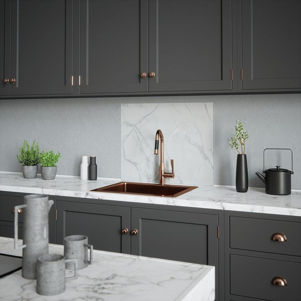 """<p>This white marble design with delicate grey veining would add timeless glamour to your kitchen.</p><p>House Beautiful Calacatta splashback (600mm x 750mm), £175.</p><p><a class=""""link rapid-noclick-resp"""" href=""""https://www.splashback.co.uk/shop/designer-splashbacks/house-beautiful/house-beautiful-calacatta-marble-splashback/"""" rel=""""nofollow noopener"""" target=""""_blank"""" data-ylk=""""slk:BUY NOW"""">BUY NOW</a><br></p>"""