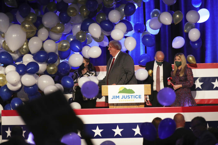 West Virginia Gov. Jim Justice, center, celebrates his reelection at The Greenbrier Resort, Tuesday, Nov. 3, 2020, in White Sulphur Springs, W.Va. (AP Photo/Chris Jackson)