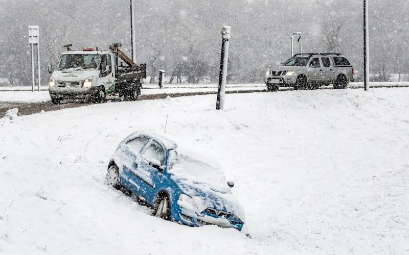 Heavy snow in North Yorkshire has caused problems for motorists - DANNY LAWSON/PA