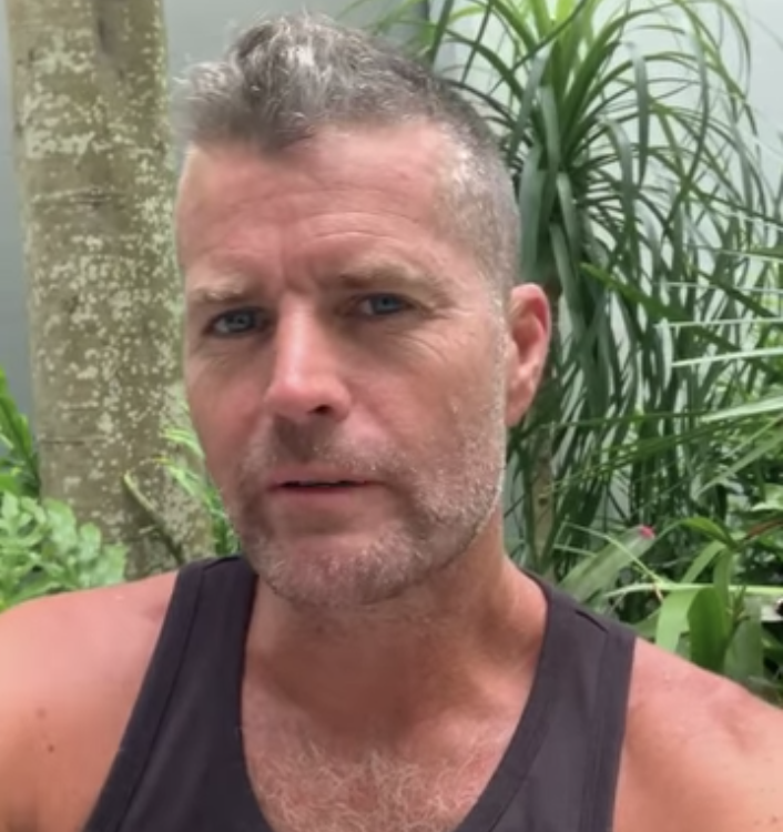 Pete Evans in a black tank top looking at the camera