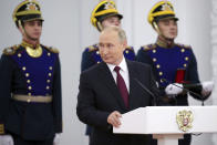 Russian President Vladimir Putin speaks while marking Day of Russia at the Grand Kremlin Palace in Moscow, Russia, Saturday, June 12, 2021. Since 1992, Russia Day is annually celebrated on 12 June as the Russian Federation's national holiday. (Mikhail Klimentyev, Sputnik, Kremlin Pool Photo via AP)