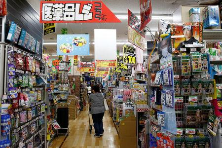 A shopper browses products at Japanese discount retailer Don Quijote Holdings' store in Tokyo, Japan, June 18, 2018. Picture taken on June 18, 2018. REUTERS/Kim Kyung-Hoon