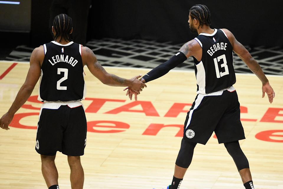 Kawhi Leonard and Paul George celebrate in the fourth quarter of the Clippers' Game 3 win over the Jazz.
