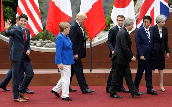 <p>G7 leaders from left, Canadian Prime Minister Justin Trudeau, German Chancellor Angela Merkel, U.S. President Donald Trump, French President Emmanuel Macron, Italian Prime Minister Paolo Gentiloni, Japanese Prime Minister Shinzo Abe and British Prime Minister Theresa May leave the podium after a group photo at the G7 Summit in the Ancient Theater of Taormina ( 3rd century BC) in the Sicilian citadel of Taormina, Italy, Friday, May 26, 2017. (Photo: Andrew Medichini/AP) </p>