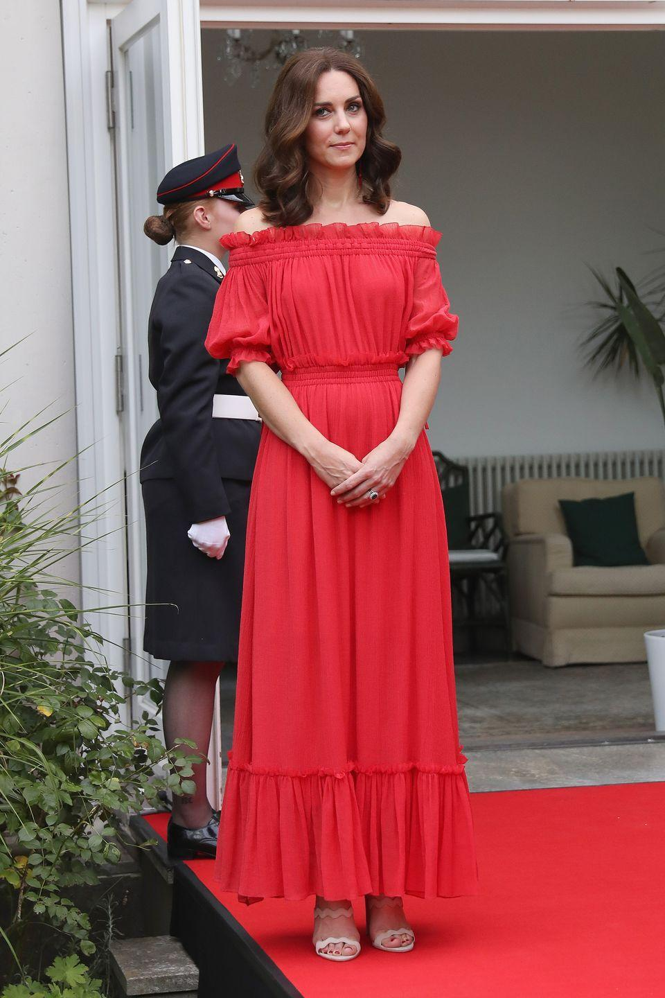 <p>The red off-the-shoulder Alexander McQueen dress Kate Middleton wore in Berlin in 2017 was a bold choice for the Duchess — and dare we say Jasmine inspired? </p>