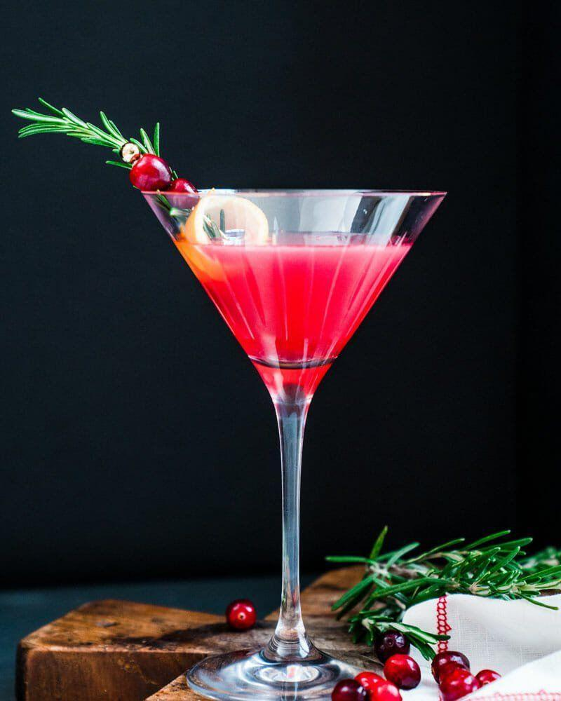 """<p>If a traditional vodka or gin martini has a little too much bite for your taste, try this Christmas version. It's a little sweeter, thanks to cranberry juice and Cointreau. </p><p><em>Get the recipe at <a href=""""https://www.acouplecooks.com/christmas-martini/"""" rel=""""nofollow noopener"""" target=""""_blank"""" data-ylk=""""slk:A Couple Cooks"""" class=""""link rapid-noclick-resp"""">A Couple Cooks</a>. </em></p>"""