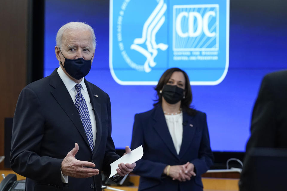 President Joe Biden speaks as Vice President Kamala Harris listens during a COVID-19 briefing at the headquarters for the Centers for Disease Control and Prevention, Friday, March 19, 2021, in Atlanta. (AP Photo/Patrick Semansky)