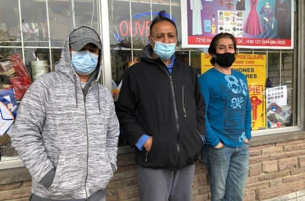 Mahbubul Hawke, 54, Mukhtar Ahmed, 45, and Zahid Hussain, 52, are Uber drivers and friends, and waited in line together to get their vaccine.