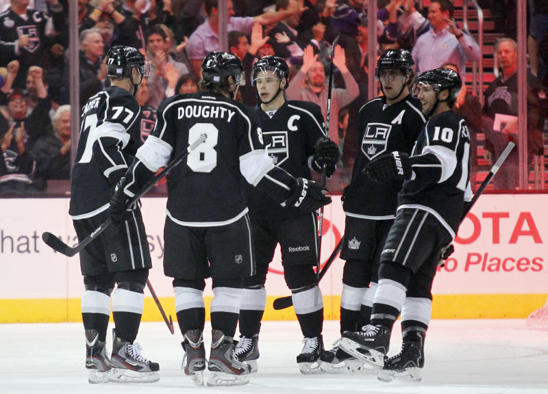 Los Angeles Kings celebrate a goal by Kings center Jeff Carter (77) during the first period of their NHL hockey game against the Ottawa Senators, Wednesday, Oct. 9, 2013, in Los Angeles. (AP Photo/Alex Gallardo)