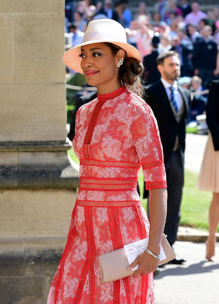 <p>Meghan Markle's co-star Gina Tores, who plays Jessica Pearson in hit US show Suits, arrives wearing a pretty, lace embellished red dress. [Photo: Getty] </p>