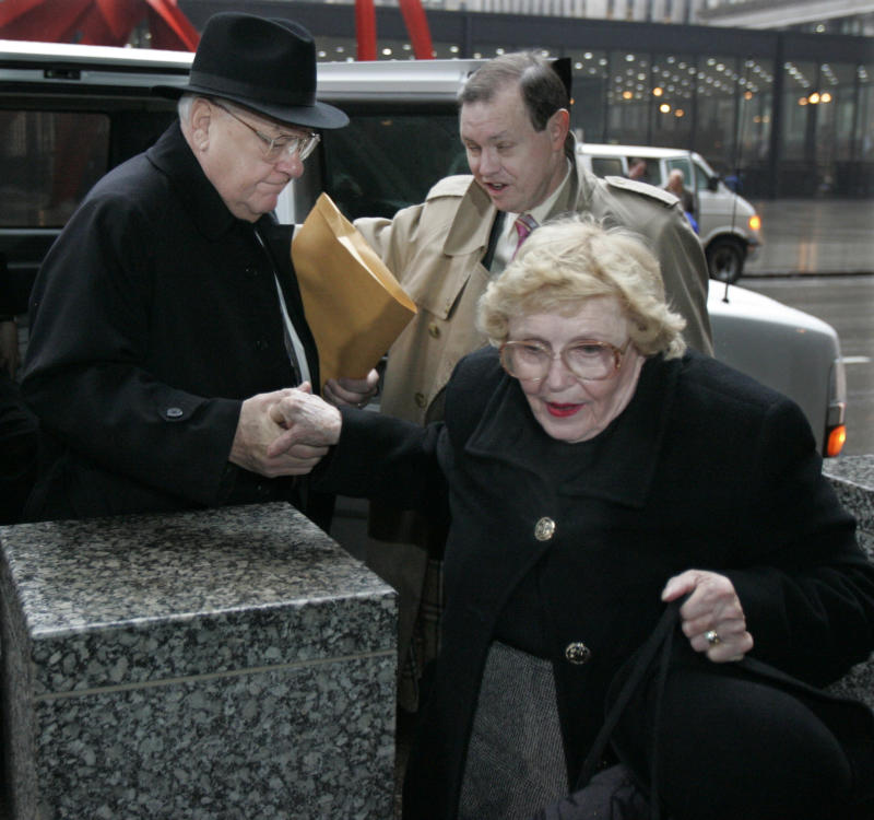 FILE - In this March 6, 2006 file photo, Former Illinois Gov. George Ryan, left, arrives at federal court in Chicago for his racketeering and corruption trial with his wife, Lura Lynn, front, and chief defense counsel Dan K. Webb.  A federal judge Tuesday upheld former Illinois Gov. George Ryan's fraud convictions and denied his request to be released from prison, bringing to an end his bid to spend his wife's final days at her side. (AP Photo/M. Spencer Green)
