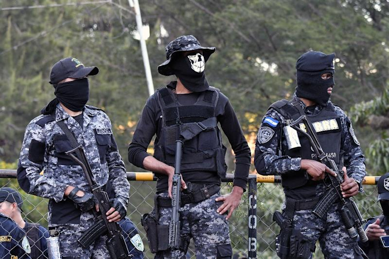 "Police officers belonging to the anti-riot ""Cobra"" unit in Honduras are refusing to enforce a curfew put in place by the government, raising tensions in Tegucigalpa (AFP Photo/JOHAN ORDONEZ)"