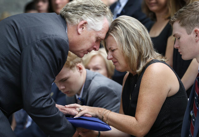 Virginia Gov. Terry McAuliffe hands Karen Cullen, the widow of Lt. H. Jay Cullen, the flag during a funeral service at Southside Church of the Nazarene in Chesterfield, Va., on Aug. 19, 2017. (Photo: Alexa Welch Edlund /Richmond Times-Dispatch via AP)