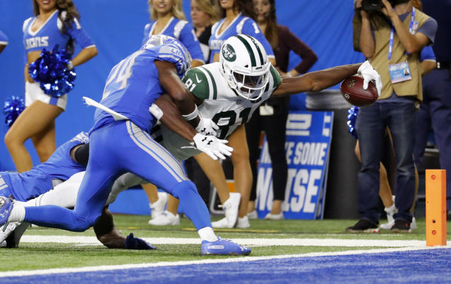 New York Jets wide receiver Quincy Enunwa (81) reaches to score on a 21-yard touchdown reception as Detroit Lions defensive back Nevin Lawson (24) defends during the second half of an NFL football game in Detroit, Monday, Sept. 10, 2018. (AP Photo/Rick Osentoski)