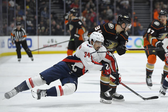 Washington Capitals defenseman Jonas Siegenthaler, left, and Anaheim Ducks center Sam Steel compete for the puck during the second period of an NHL hockey game Friday, Dec. 6, 2019, in Anaheim, Calif. (AP Photo/Mark J. Terrill)