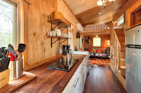 """<p>One of Tumbleweed Tiny House Company's newer models, the Roanoke can sleep up to six people and features a shed style roof.<br></p><p><a class=""""link rapid-noclick-resp"""" href=""""https://go.redirectingat.com?id=74968X1596630&url=https%3A%2F%2Fwww.tumbleweedhouses.com%2Ftumbleweed-models%2Froanoke%2F%23%21&sref=https%3A%2F%2Fwww.countryliving.com%2Fhome-design%2Fg1887%2Ftiny-house%2F"""" rel=""""nofollow noopener"""" target=""""_blank"""" data-ylk=""""slk:SHOP NOW"""">SHOP NOW</a> <a class=""""link rapid-noclick-resp"""" href=""""https://go.redirectingat.com?id=74968X1596630&url=https%3A%2F%2Fwww.tumbleweedhouses.com%2Ftiny-houses-for-sale%2Froanoke%2F%23%21&sref=https%3A%2F%2Fwww.countryliving.com%2Fhome-design%2Fg1887%2Ftiny-house%2F"""" rel=""""nofollow noopener"""" target=""""_blank"""" data-ylk=""""slk:SEE INSIDE"""">SEE INSIDE</a></p>"""