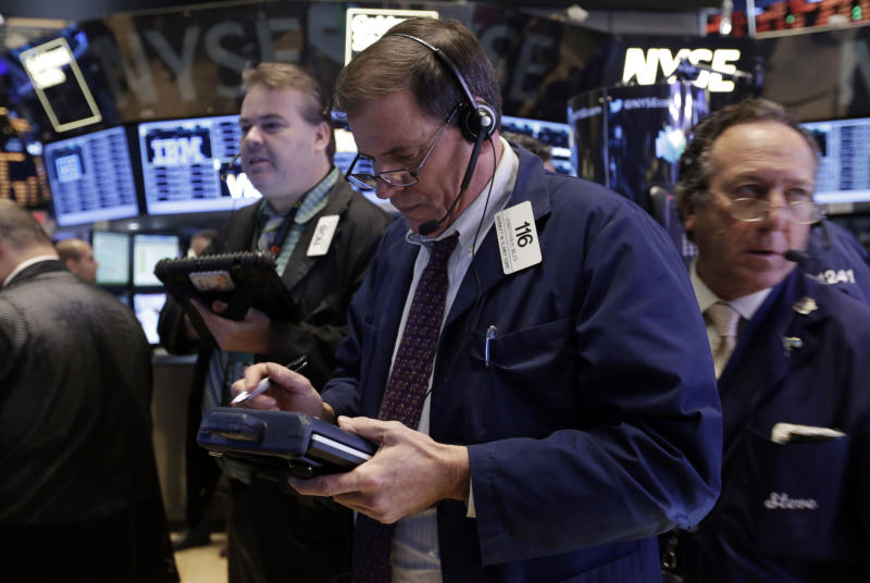 Jonathan Niles, center works with fellow traders on the floor of the New York Stock Exchange Friday, Nov. 8, 2013. Stocks edged higher in early Friday trading as investors reacted to an unexpectedly strong October jobs report. (AP Photo/Richard Drew)