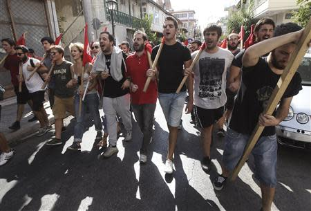 Protesters shout slogans during an anti-fascist rally following the killing of Greek rapper Pavlos Fissas by a supporter of the far-right Golden Dawn group, in Nikaia, a suburb of Athens September 21, 2013. REUTERS/John Kolesidis