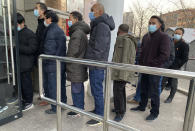 "FILE - In this Tuesday, Jan. 12, 2021 file photo, people line up for COVID-19 vaccinations in Beijing. Health officials around the world are racing to vaccinate enough people to stop the spread of the coronavirus -- but what qualifies as ""enough"" is still an open question. (AP Photo/Ng Han Guan)"