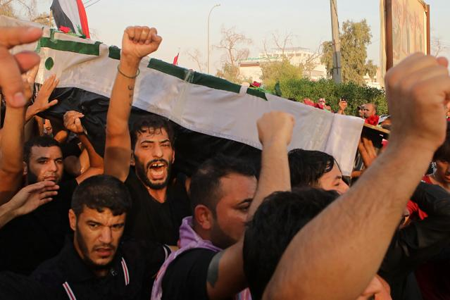 <p>Mourners chant anti government slogans while carrying the Iraqi flag-draped coffin of Abdul Salam Fathi, a protester whose family said he was killed when he participated in a protest last night, during his funeral in Basra, 340 miles (550 km) southeast of Baghdad, Iraq, Friday, Sept. 7, 2018. Hundreds of angry protesters in Basra took to the streets on Thursday night. Some clashed with security forces, lobbing Molotov cocktails and setting fire to a government building as well as the offices of Shiite militias. At least three people were shot dead in confrontations with security forces. (Photo: Nabil al-Jurani/AP) </p>