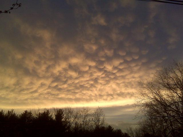 """<a target=""""_blank"""" href=""""http://www.flickr.com/photos/mstyne/4498567422/"""">Mammatus Clouds</a>. Spied over my neighbors house as I returned from a hard day's work. This photo was taken on April 6, 2010 in Sand Lake, New York, US, using a RIM BlackBerry 8330."""