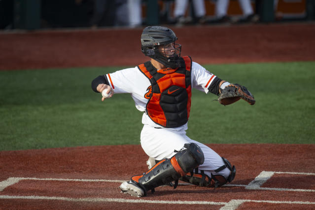 FILE - In this April 26, 2019, file photo, Adley Rutschman catches for Oregon State during an NCAA college baseball game against Washington State in Corvallis, Ore. The Baltimore Orioles lead off the Major League Baseball Draft for the first time in 30 years and Oregon State catcher Adley Rutschman is a heavy favorite to be selected No. 1 on Monday night, June 3, 2019. (AP Photo/Chris Pietsch, File)